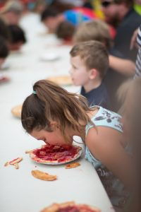 Kids dig in for the pie eating contest. (Photo Credit: Brook Hedge)