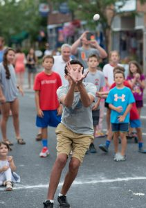 A child participating in the Egg toss. (Photo Credit: Brook Hedge)