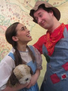 Dorothy (Marissa Barnathan) meets a brainless scarecrow (Eric Dann) along The Yellow Brick Road.