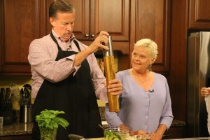 Jimmy and Deborah admiring the pepper mill while cooking in the kitchen
