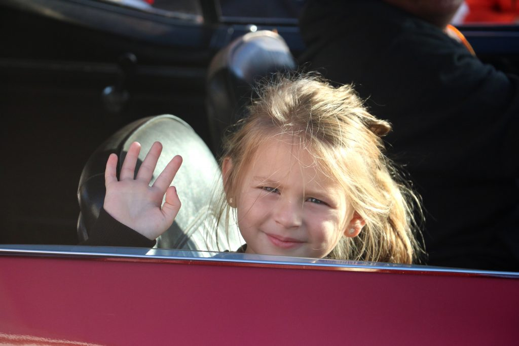 A participant waves while riding in the boardwalk parade (Photo:Laura Landry/WBOC)