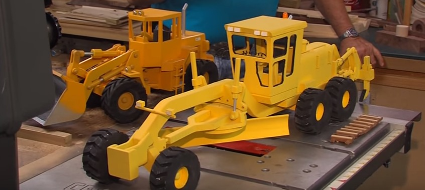 Local Woodworker Hand Carves Dump Trucks and Has a Story Behind Each Piece of Art