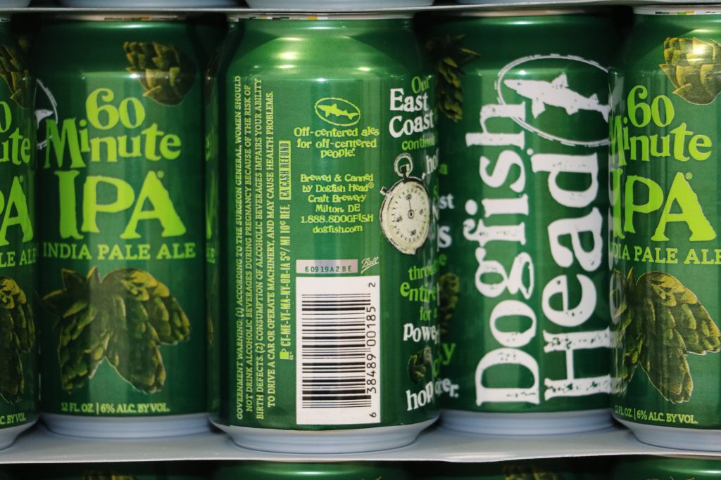Dogfish Head Unveils 60 Minute IPA Cans with Off-Centered Touch