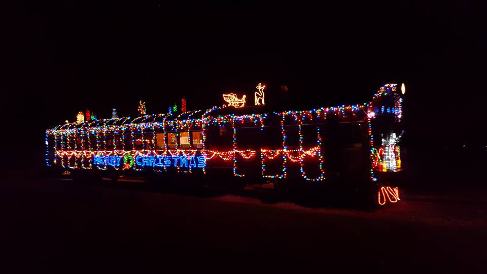 the holiday lights train a 1920s railcar is fully adorned with thousands of lights photo wilmington western facebooktommy gears - Christmas Light Train