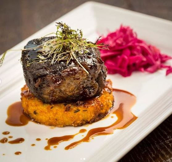 Beef Short Ribs with an Orange Cilantro Jalapeno Glaze on a Fried Cheesy Grit Cake with Poseidon's Pub