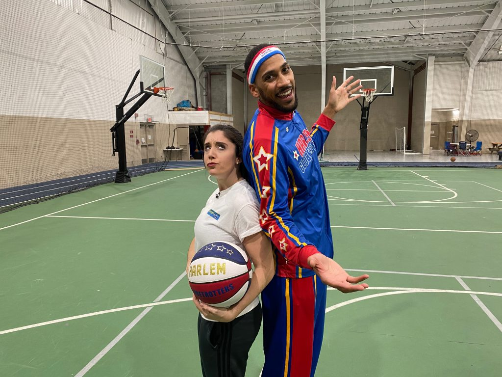 Harlem Globetrotter Shows Katie his Skills