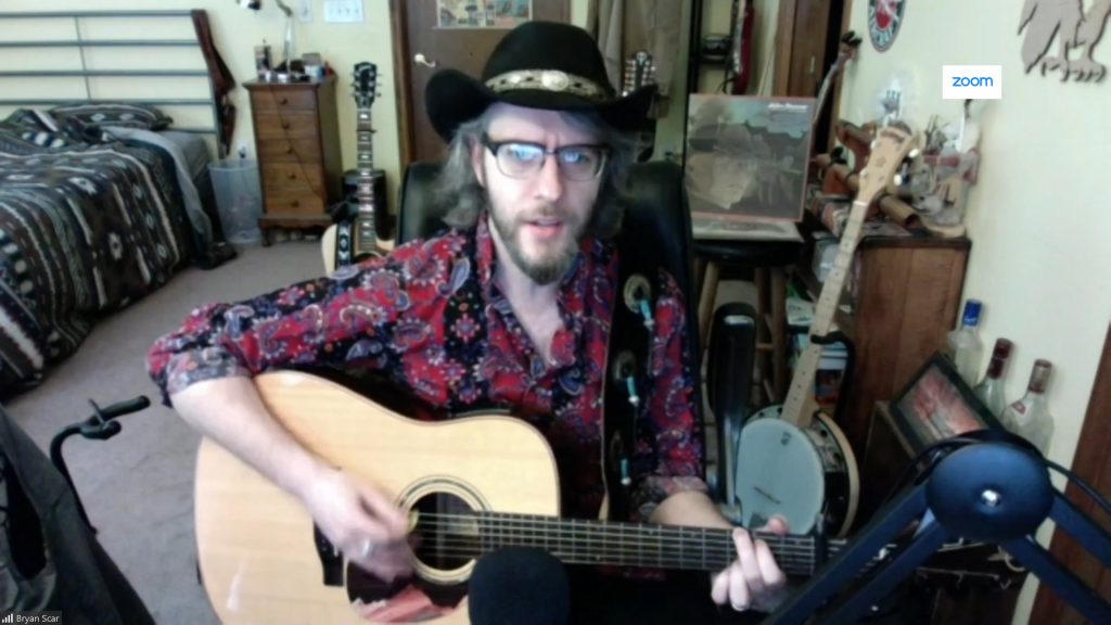 "Bryan Scar Performs Original Song, ""Dire Times"""