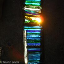 Light Blessings, Arrow-slit design stained glass window feature for exterior wall