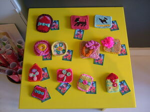 Knitted and needlepoint brooches