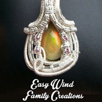 Sterling silver wire wrapped pendants and rings.