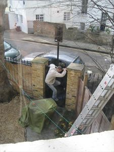 Builders clambering into back garden to get access to roof