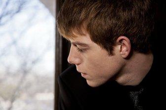 Teen-boy-pensive-lr