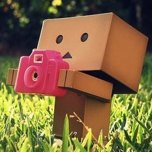 Cardboardpersonwithacamera