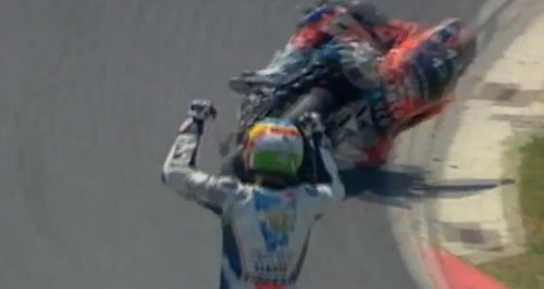 Motorcycle racer celebrates win a lap early