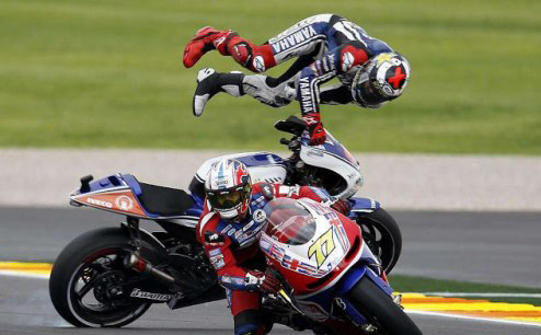 MotoGP champ finishes season by flying high - literally