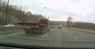 Truck in the left lane: What's wrong with this picture?