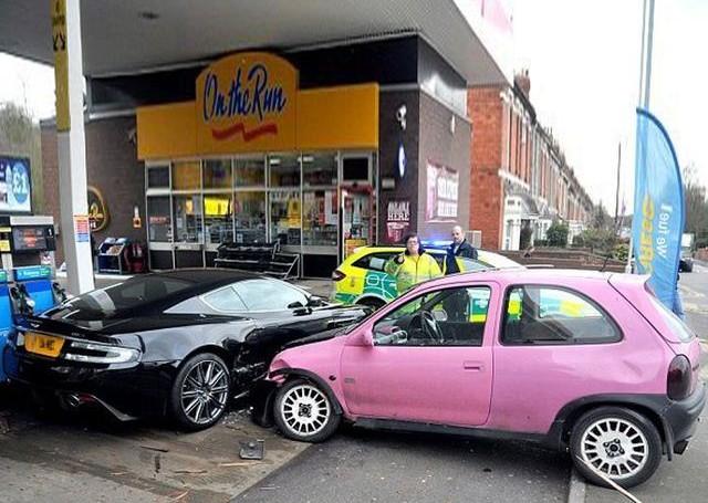 Pink beater wrecks Aston Martin after roundabout error