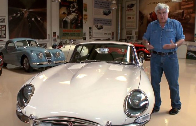 Jay Leno checks out a Jaguar XKE