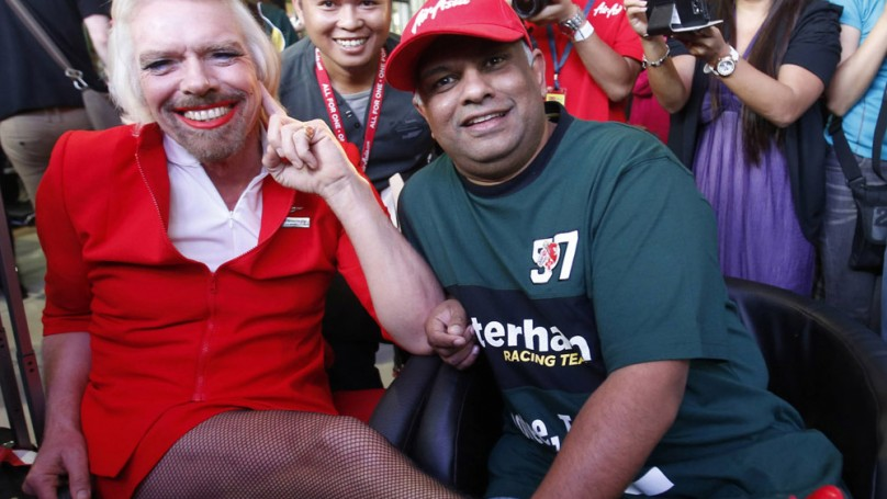 Billionaire Branson loses bet, <br>gains lipstick and fishnets