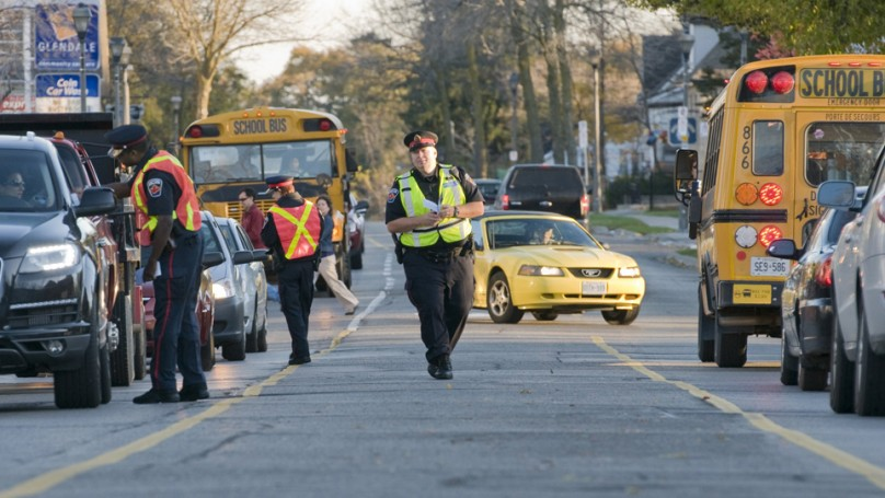 School bus stopped at T-intersection is a tricky situation