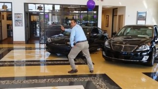 Insider Report: Car salesman busts a move in the showroom