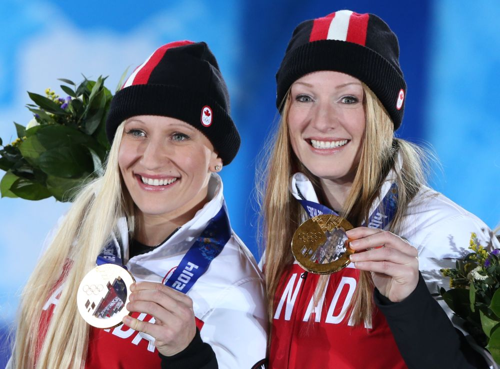 Canada's gold medalists pilot Kaillie Humphries and brakewoman Heather Moyse pose during the Women's Bobsleigh Medal Ceremony at the Sochi medals plaza during the Sochi Winter Olympics on February 20, 2014.  AFP PHOTO / LOIC VENANCELOIC VENANCE/AFP/Getty Images