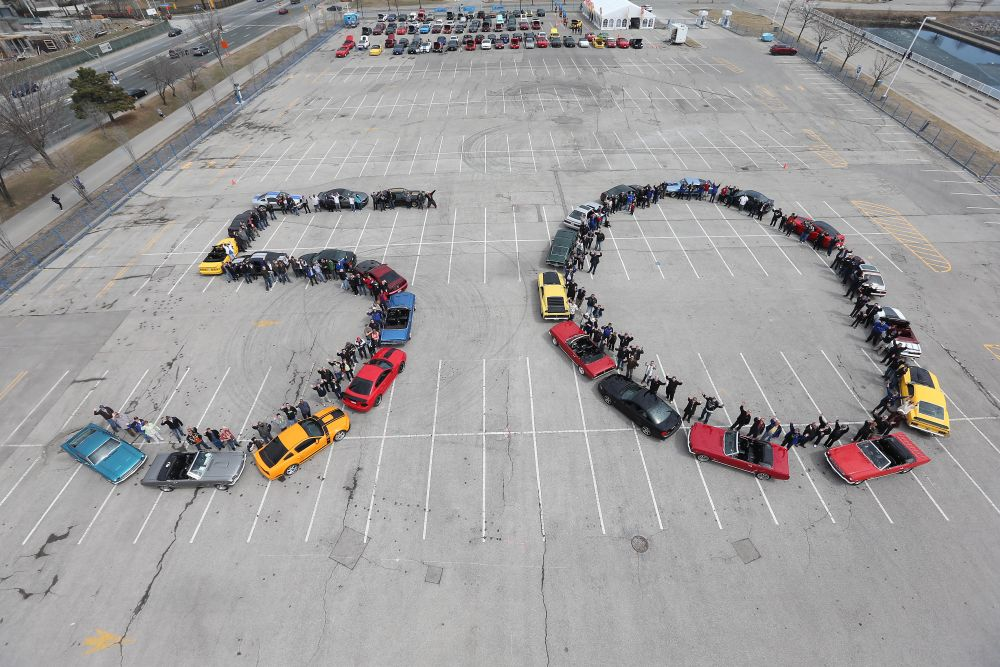 """Ford Mustang cars lined up to spell out """"50"""""""