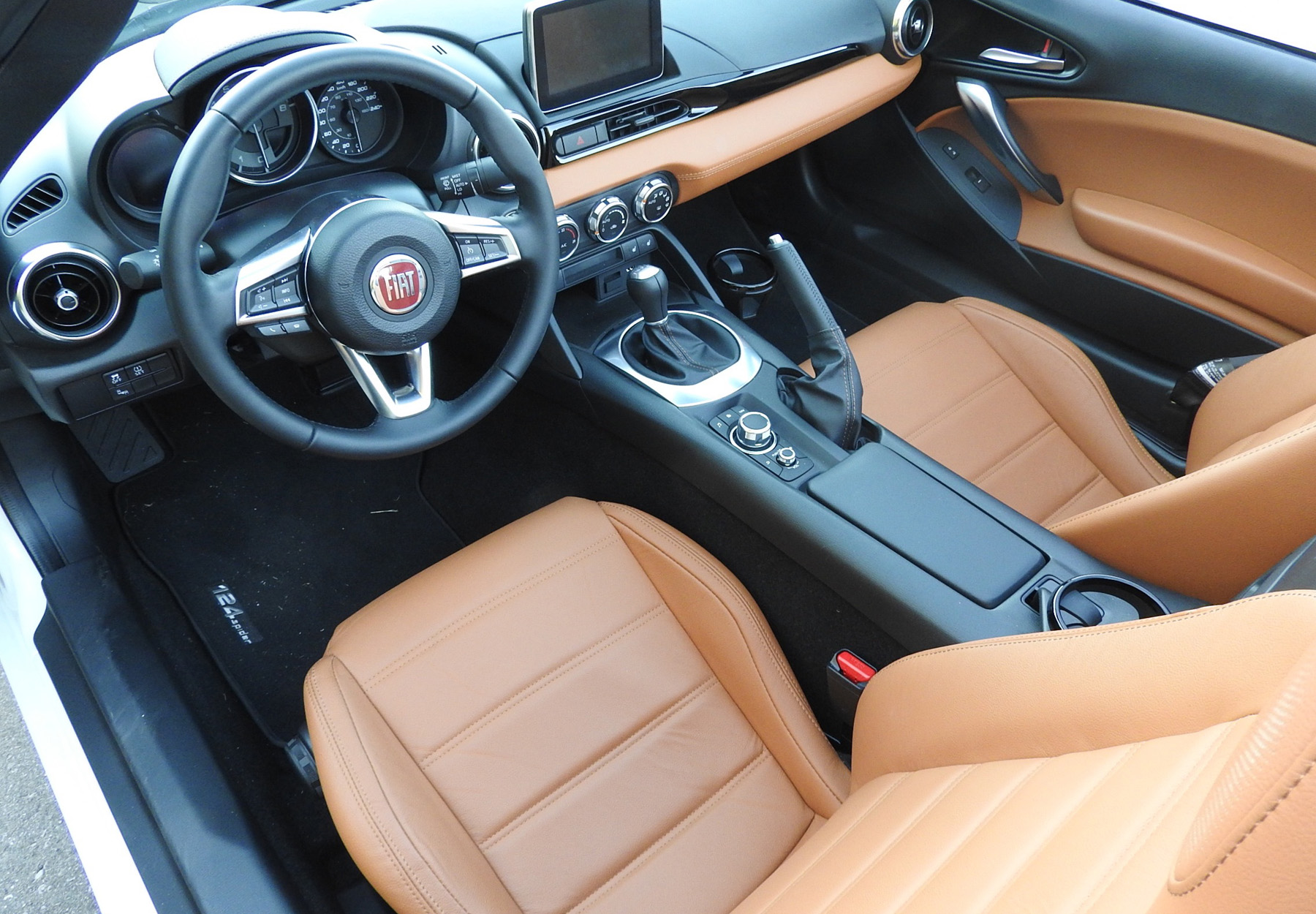 fiat brings italian flare to the roadster market. Black Bedroom Furniture Sets. Home Design Ideas