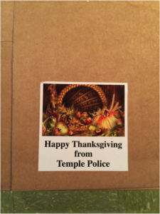 """The Temple Police Department hosted its annual Thanksgiving """"Turkey Box"""" food drive on Thursday, Nov. 19. (Photo by: Ryan Goodwin)"""