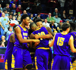 The purple-clad Cahillites celebrate after winning their second consecutive PCL title. (Photo by: Anthony Simuro)