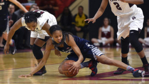 Feb 14, 2016; Philadelphia, PA, USA; Connecticut Huskies guard Moriah Jefferson (4) dives past Temple Owls guard Alliya Butts (0) and guard Feyonda Fitzgerald (2) for a loose ball during the first quarter at McGonigle Hall. Mandatory Credit: Derik Hamilton-USA TODAY Sports