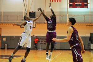 St. Joe's Prep's Temi Aiyebushi with the jumper over Tony Carr. (Photo by Anthony Simuro)