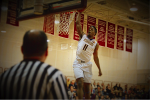 Roman's Lamar Stevens with the one-handed slamdunk for the Cahillites. (Photo by: Anthony Simuro)