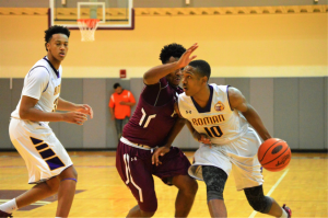 Roman's Tony Carr drives to the hoop. (Photo by: Anthony Simuro)