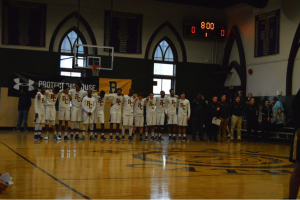 Roman lines up for the National Anthem. (Photo by: Anthony Simuro)