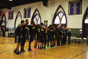 Bishop McDevitt lines up for the National Anthem. (Photo by: Anthony Simuro)