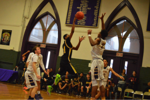 Bishop McDevitt Guard, Bishop McDevitt's Da'Quane Williams with the floater over Lamar Stevens. (Photo by: Anthony Simuro)