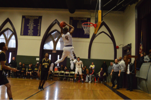 Roman Catholic High School's senior Nazeer Bostick floats through the air for the first dunk of the game. (Photo by: Anthony Simuro)