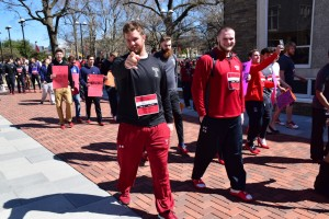 "Temple men donned red high heels in support of females everywhere. The ""Walk A Mile In Her Shoes"" event took place right on Temple's campus to raise awareness about rape and sexual assault. (Photo credit: Eric White)"