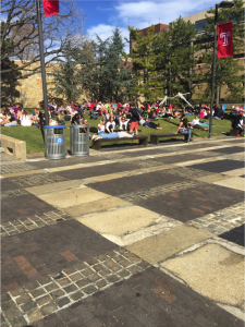 Activity on Temple's campus seems to increase tenfold when the weather gets nice as students enjoy sitting out in the sun on Beury Beach. (Photo by: Ryan Goodwin)