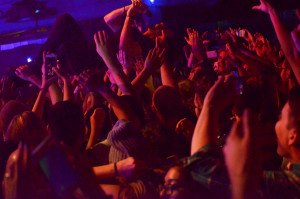 """Taylor Rice crowd-surfs during the band's performance of """"Sun Hands."""" (Photo: Emily Tobin)"""