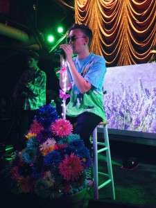 Gnash serenades the crowd at his flower-adorned microphone stand (Photo: Kija Chronister