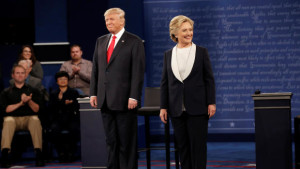 Republican U.S. presidential nominee Donald Trump and Democratic U.S. presidential nominee Hillary Clinton appear together during their presidential town hall debate at Washington University in St. Louis, Missouri (Photo: cbsnews.com)