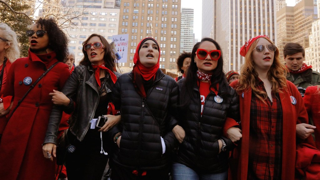 "Women wear red in solidarity with Wednesday's ""Day Without a Woman"" strike. (Photo: AOL.com)"