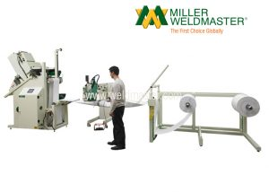 Image of Filter Ultrasonic Welding Machine and Worker