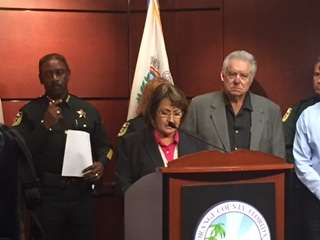 File photo: Orange County Mayor Teresa Jacobs launched a heroin task force, and Orange County Sheriff Jerry Demings, left, and time share magnate David Siegel joined the announcement.
