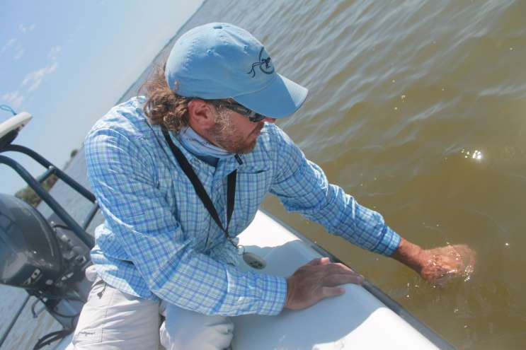 Rick Worman, a Merritt Island fishing guide, is hoping for clearer water. Photo by Amy Green