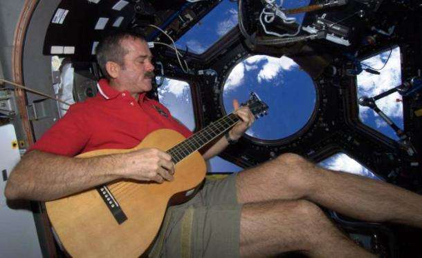 To pass the time, Canadian Astronaut Chris Hadfield plays guitar. His music videos made quite the splash on social media. Photo: NASA