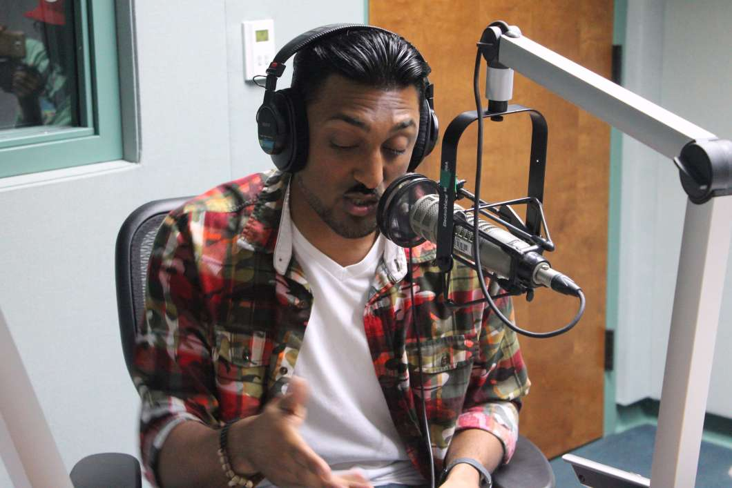 Ken Nai performs in the WMFE studios. Photo: Brendan Byrne