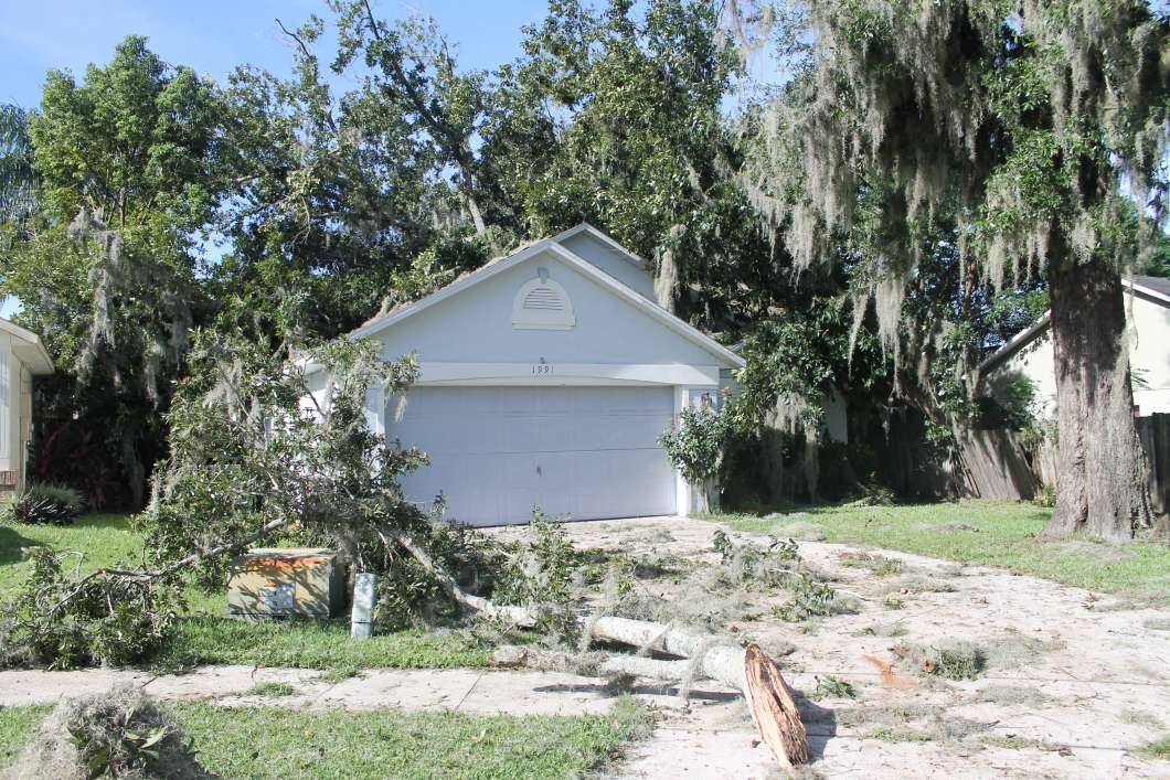 Hurricane Matthew sent a tree through the roof of this Apopka home. Photo by Amy Green